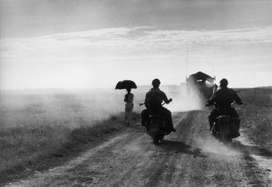 INDOCHINA (VIETNAM). May 25th, 1954. Motorcyclists and woman walking on the road from Nam Dinh to Thai Binh.